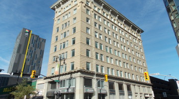 Street view front exterior of 283 Portage Avenue in Winnipeg, MB.